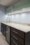 Basement with stone counter tops and carpet floor. Stock Photos
