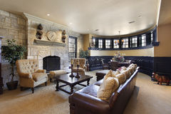 Basement with stone fireplace. Basement in luxury home with stone fireplace Stock Photography