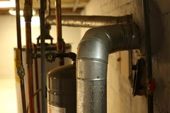 Basement view. With water heater, furnace and pipes Royalty Free Stock Images