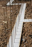 Basement wall footing with deadman. Footing for a basement wall with rebar and wooden forms Stock Image