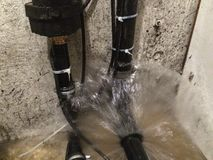 Basement water damage-. Water pouring into the basement creating severe damage Stock Images