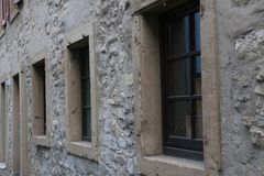 Basement windows in the old city street.  royalty free stock photo