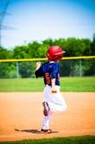 Basebollspelarespringbaser Arkivfoton