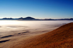 Bashang grassland in autumn, morning mist. This photo was taken at Bashang grassland in Inner Mongolia on Sep.26, 2006。This place is called General Wetlands Royalty Free Stock Photos