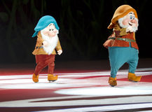 Bashful and Happy Dwarves. GREEN BAY, WI - MARCH 10: Bashful and Happy Dwarves from Snow White in skates at the Disney on Ice Treasure Trove show at the Resch Royalty Free Stock Photo