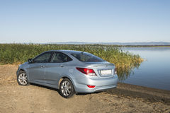 Bashkortostan, Russia - August 3, 2015: The car is a Hyundai Accent on the lake. Stock Photo