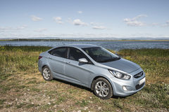 Bashkortostan, Russia - August 3, 2015: The car is a Hyundai Accent on the lake. Royalty Free Stock Image