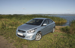 Bashkortostan, Russia - August 3, 2015: The car is a Hyundai Accent on the lake. Stock Image