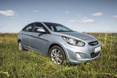 Bashkortostan, Russia - August 3, 2015: Car Hyundai Accent in nature. Stock Photos