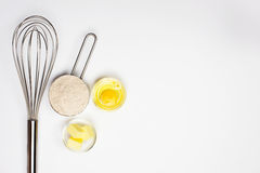 Basic baking background. Egg butter flour on white table background,basic baking background royalty free stock photo
