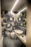 Basic bathroom with grey tiles. That look like fabric Stock Photos