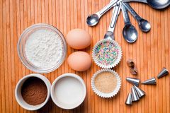 Basic cake and muffin ingredients on wooden background Royalty Free Stock Photo