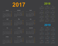 Basic calendar template, years 2017, 2018, 2019, gray background. Basic calendar of years 2017, 2018, 2019, sundays marked in light orange, green and blue, dark Stock Image