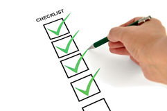 Basic checklist. Checklist marked green with a green pen Royalty Free Stock Photography