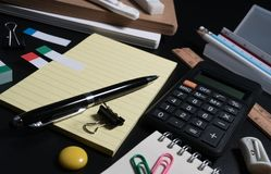 Basic and classic office business supplies. Set of school supplies or business supplies concept. Close up of office business supplies on black background in royalty free stock images