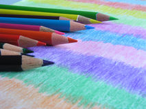 Basic Colors III-Colored Pencils. Third in the Basic Colors series; assortment of colored pencils on colored paper Stock Photography