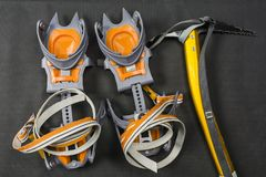 Basic crampons and ice axe. Basic crampons and ice axe for winter hiking on trails stock photos
