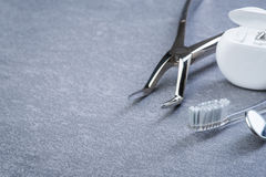 Basic dental tools, floss and brush on grey surface Stock Photo