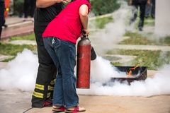 Basic Fire Fighting and Evacuation Fire Drill Simulation Training For Safety. In Condominium or Factory stock image