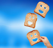 Basic food abundance - bread. Slices flying against blurry blue background stock photo