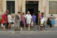 Basic food distribution point at church in palma Royalty Free Stock Photography