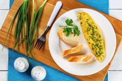 Basic French omelette on white plate Stock Photo