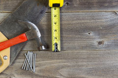 Basic home repair tools on weathered wood Stock Photos
