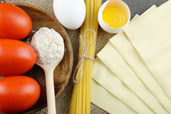 Basic ingredients for cooking Italian pasta. Royalty Free Stock Photo