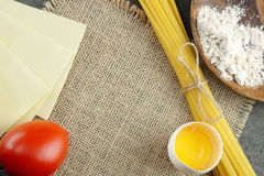 Basic ingredients for cooking Italian pasta. Stock Photos