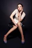 Basic Instinct. Woman sitting. Studio shot Stock Images