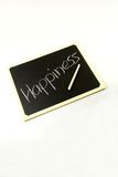 Basic lessons of happiness. Happiness written on a blackboard Royalty Free Stock Photography
