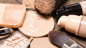 Basic makeup products for flawless complexion. Foundation, concealer, powder, cosmetic sponge, professional makeup brushes. Selective focus Stock Photo