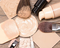Basic makeup products for flawless complexion. Basic make up products for flawless complexion: foundation, concealer, powder with cosmetic sponge and Stock Photo