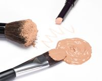 Basic makeup products to create beautiful skin tone on white. Basic makeup products to create beautiful skin tone: concealer, foundation, cosmetic powder on Stock Images