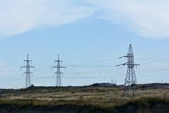 Basic masts of power lines in twilight Royalty Free Stock Images
