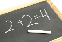 Basic Math Equation. A young student has solved a basic math equation on a chalkboard stock images