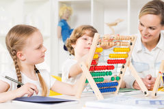 Basic maths training with the use of abacus Stock Photography