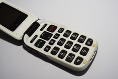 Basic mobile phone. Simple, simplistic and old fashioned flip phone stock photo