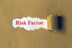 Risk factor heading. Under ripped paper stock images