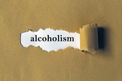 Alcoholism heading. Behind brown torn paper royalty free stock images