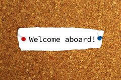 Welcome aboard heading. Welcome aboard typed message pinned to noticeboard royalty free stock photos