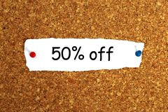 50% off sign. 50% off heading pinned to cork board stock photos