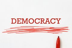 Democracy heading. Underlined with red felt-tip pen stock photography