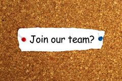 Join our team. Heading on ripped paper pinned to cork board royalty free stock photo