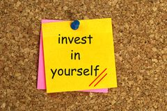 Invest in yourself. Heading on post-it note royalty free stock photo