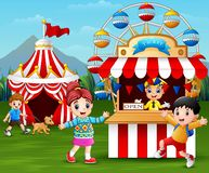 Happy children having fun in the amusement park. Illustrtaion of Happy children having fun in the amusement park royalty free illustration