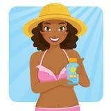 Dark skinned girl holding sunscreen royalty free stock image