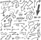 Set of Hand drawn arrows doodle stock illustration
