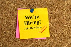 We're hiring sign. We're hiring notice on post-it on cork board royalty free stock photography
