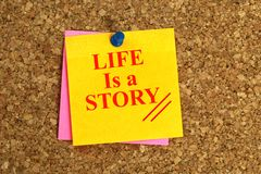 Life is a story heading. On post-it pinned to cork board royalty free stock photography